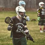 Chłopiec lacrosse obraz royalty free