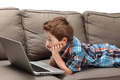 chłopiec laptop Zdjęcie Stock