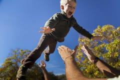 Chłopiec latająca wysokość Obrazy Stock