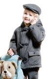 Chłopiec lub dzieciak opowiada na telefonu komórkowego szczęśliwy ono uśmiecha się Zdjęcia Royalty Free