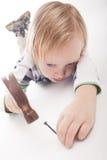 chłopiec młota gwóźdź Obrazy Royalty Free