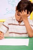 chłopiec małych praca domowa kłopoty obrazy royalty free