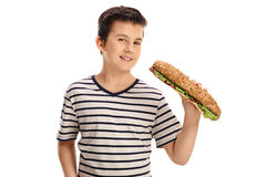 Chłopiec ma kanapkę i patrzeje kamerę Obrazy Royalty Free