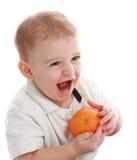 chłopiec mienia pomarańcze Obrazy Royalty Free