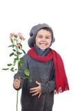 Chłopiec mienie wzrastał kwiaty Fotografia Stock