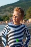 Chłopiec na plaży w pasiastej kamizelce Fotografia Stock