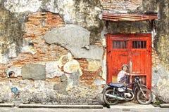 Chłopiec na roweru malowidle ściennym Obrazy Royalty Free