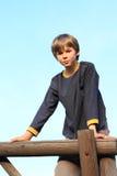 Chłopiec na wierzchołku Zdjęcia Stock