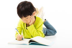 Chłopiec nauka na podłoga zdjęcia royalty free