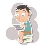 Chłopiec obsiadanie na stosie książki i używać cyfrową pastylkę Fotografia Royalty Free
