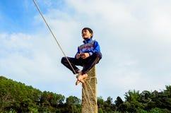 Chłopiec obsiadanie na wysokości Obrazy Royalty Free