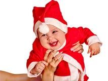 Chłopiec odzież dla Santa kapeluszy trzyma boże narodzenia Zdjęcia Royalty Free