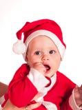 Chłopiec odzież dla Santa kapeluszy trzyma boże narodzenia Zdjęcie Royalty Free