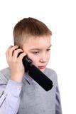 Chłopiec opowiada na telefonie komórkowym Zdjęcie Stock
