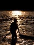 Chłopiec paddle abordaż Obrazy Royalty Free