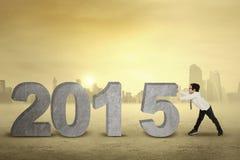 Chłopiec pchnięcie liczba 2015 outdoors Zdjęcie Stock