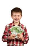 Chłopiec pokazuje jego pieniądze Obraz Royalty Free