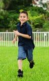 chłopiec potomstwa szczęśliwi działający Zdjęcia Royalty Free