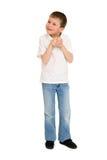 Chłopiec pozuje na bielu Zdjęcia Royalty Free