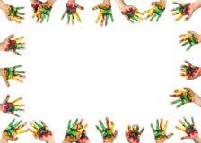 Chłopiec ręki malować z kolorową farbą royalty ilustracja