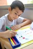 chłopiec robić engross pracy domowej jego writing obrazy royalty free