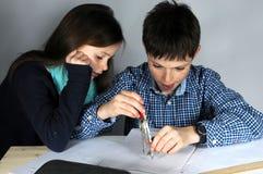 Chłopiec robi maths pracie domowej Zdjęcie Royalty Free