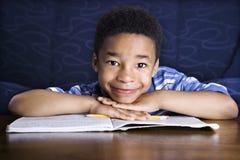 chłopiec robi pracie domowej Obraz Stock