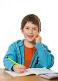 chłopiec robi pracie domowej Fotografia Royalty Free