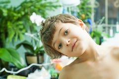 Chłopiec robi twarzom indoors Obraz Royalty Free