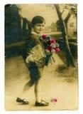 chłopiec rocznik mały pocztówkowy zdjęcie royalty free