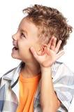 Chłopiec słucha plotkować obraz stock