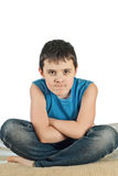 Chłopiec siedzi na białym tle Fotografia Royalty Free