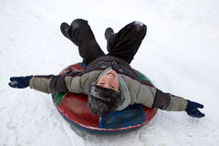 chłopiec sledding Obrazy Royalty Free