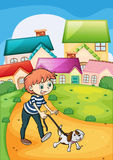 Chłopiec spaceruje z jego zwierzęciem domowym Zdjęcie Stock