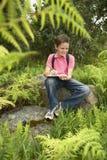 Chłopiec studiowania Writing Na schowku I rośliny zdjęcia royalty free