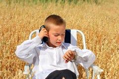 chłopiec telefon komórkowy Obrazy Royalty Free