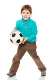 Chłopiec trzyma piłki nożnej piłkę Obrazy Royalty Free