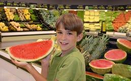 chłopiec trzymający arbuz Zdjęcia Royalty Free