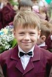 Chłopiec ucznia ono uśmiecha się Obraz Royalty Free