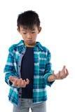 Chłopiec udaje trzymać niewidzialnego przedmiot Obraz Stock