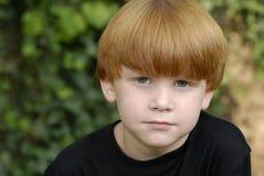 chłopiec włosiana portreta czerwień Obrazy Royalty Free