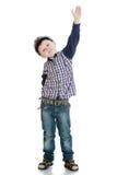 Chłopiec w żeglarza kostiumu, nastroszonym jego ręka fotografia stock