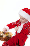 Chłopiec w bożych narodzeniach odziewa z zabawkami fotografia stock