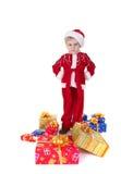 Chłopiec w bożych narodzeniach odziewa z zabawkami Zdjęcie Stock