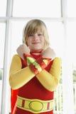 Chłopiec W bohatera kostiumu Z rękami Krzyżował Uśmiecha się Zdjęcia Stock