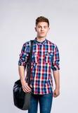 Chłopiec w cajgach i koszula, młody człowiek, studio strzał Zdjęcie Stock