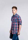 Chłopiec w cajgach i koszula, młody człowiek, studio strzał Obraz Stock