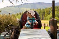 Chłopiec w ciągniku Fotografia Royalty Free
