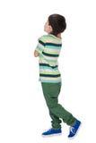 Chłopiec w koszula pasiastych spojrzeniach z powrotem obraz stock
