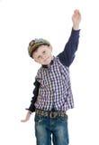 Chłopiec w morza odzieżowym falowaniu jego ręki zdjęcie stock